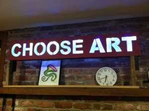 Choose Art sign on mantel