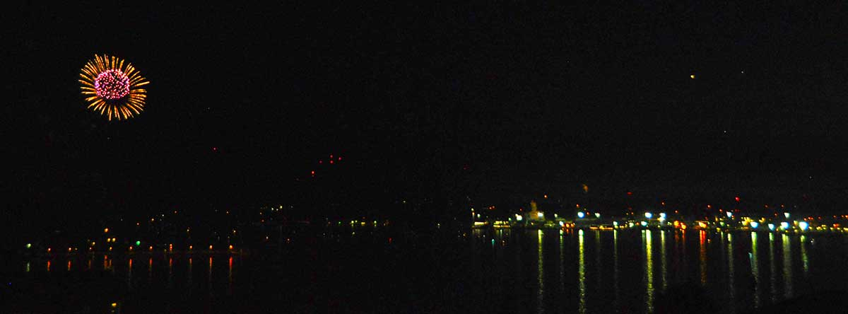 Fireworks in Sinclair Inlet and the Bremerton waterfront at night