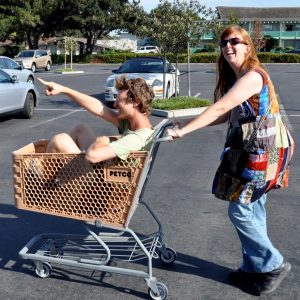 Meps pushing shopping cart with Dario in it